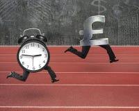 Alarm clock running after pound money symbol Stock Image