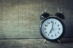 Alarm clock on rustic wood Royalty Free Stock Photos