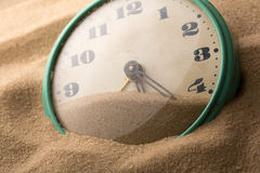 Alarm clock in sand Stock Images