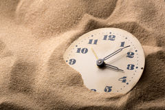 Alarm clock in sand Royalty Free Stock Photo