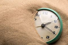 Alarm clock in sand Stock Image
