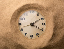 Alarm clock in sand Stock Photography