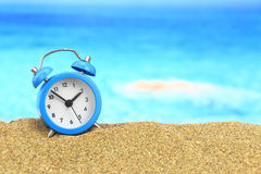 Alarm clock on the sand Stock Image