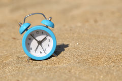 Alarm clock on the sand Royalty Free Stock Image