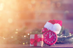Alarm clock with Santa Claus hat with Christmas Fairy Ligths Stock Photo