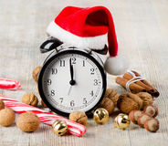 Alarm clock with Santa hat Royalty Free Stock Images