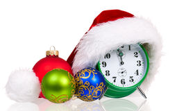 Alarm clock with santa hat royalty free stock image