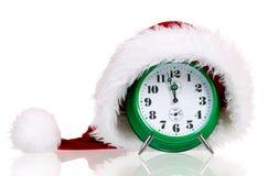 Alarm clock with santa hat Royalty Free Stock Image