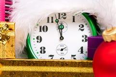Alarm clock with santa hat Stock Photos