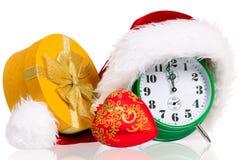 Alarm clock with santa hat Stock Photography