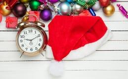 Alarm clock and santa's hat Royalty Free Stock Image