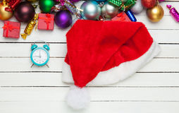 Alarm clock and santa's hat Stock Photos