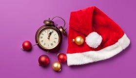 Alarm clock and Santas hat Stock Image