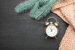 Alarm clock and scarf stock photo