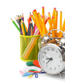 Alarm clock and school accessories Stock Images