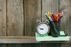 Alarm clock and school accessories . Royalty Free Stock Photos