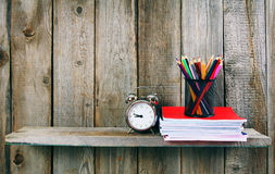 Alarm clock and school accessories . Royalty Free Stock Images