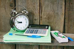 Alarm clock and school accessories. Royalty Free Stock Images