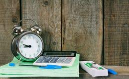 Alarm clock and school accessories. Stock Image