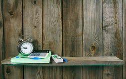 Alarm clock and school accessories. Stock Images