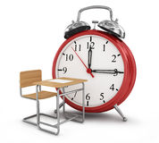 Alarm clock with school desk. Stock Photo