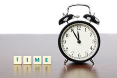 Alarm clock and Scrabble words Stock Photos