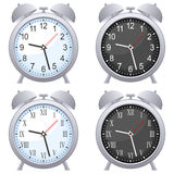 Alarm Clock Set. Gray alarm clock in four different versions (blue, black, arabic and roman numerals), isolated on white background. Eps file available Royalty Free Stock Photos