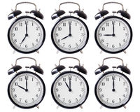 Alarm clock set with hands from 7 to 12 o'clock Stock Image