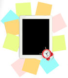 Alarm clock with set of stickers and tablet Royalty Free Stock Photography