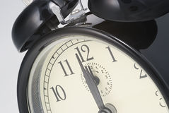 Alarm clock set to  twelve o`clock Stock Images