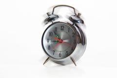 Alarm clock shake. Ringing and shakeing alarm clock royalty free stock photography