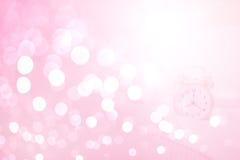 Alarm clock in shiny bokeh background Stock Image