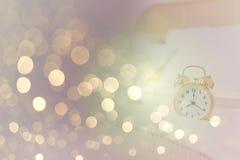 Alarm clock in shiny bokeh background Stock Photos