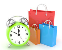 Alarm clock and shopping bag (time to buy concept. ) on white Stock Images