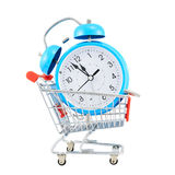 Alarm clock in a shopping cart Royalty Free Stock Photos