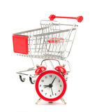 Alarm clock and shopping cart Stock Photos