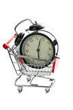 Alarm clock in shopping cart Royalty Free Stock Photos