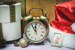 Alarm clock showing five minutes to twelve on Stock Photography