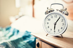 Alarm clock. Showing five past six in the morning royalty free stock photos