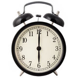 Alarm clock showing six o'clock. Royalty Free Stock Photos