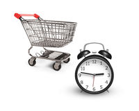 Alarm clock with small shopping cart Royalty Free Stock Images