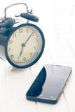 Alarm clock and smartphone Stock Photo