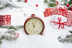 Alarm clock with snow Stock Images