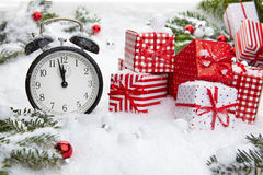 Alarm clock with snow Stock Photography