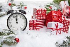 Alarm clock with snow Stock Photography