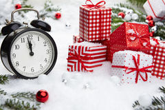 Alarm clock with snow Royalty Free Stock Photo