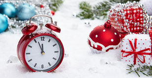 Alarm clock with snow Stock Image
