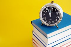 Alarm Clock on Stack of Books Royalty Free Stock Photography