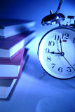 Alarm clock and stack of books Royalty Free Stock Images