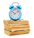 Alarm clock on the stack of books Royalty Free Stock Image